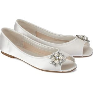 White flat wedding shoes by Pink paradox London